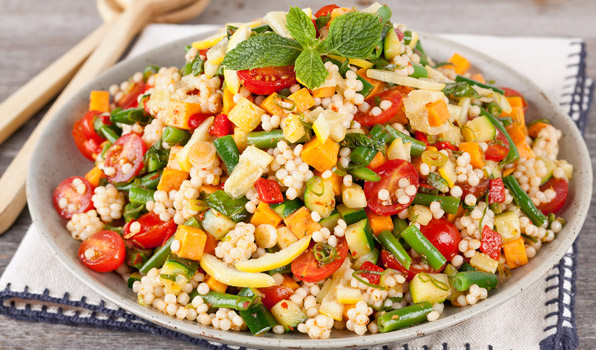 in the kitchen with stefano faita veggie couscous salad with harissa dressing served in a dish