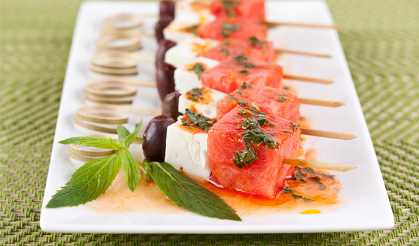 in the kitchen with stefano faita watermelon and feta salad served with dressing drizzled on top
