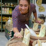 Picture Shows: Michela at bean stall with handful of dried chickpeas