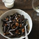 Chocolate pasta with pecans and caramel