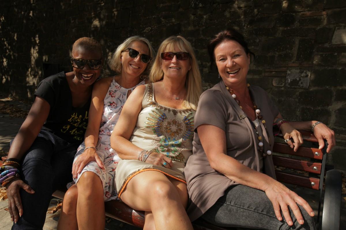 Four women smiling