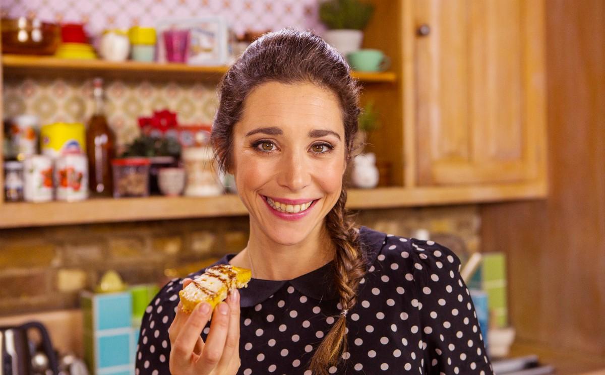 Michela holding a slice of Crispy Polenta with Balsamic glaze