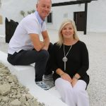 Guest couple poses in front of their newly renovated hotel